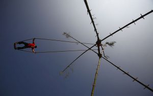 A Nepalese youth plays on a swing during the first day of Dashain, Hinduism's biggest religious festival, in Kathmandu October 16, 2012. Hindus in Nepal celebrate victory over evil during the festival by sacrificing animals and worshipping the Goddess Durga as part of celebrations held throughout the country. REUTERS/Navesh Chitrakar (NEPAL - Tags: RELIGION SOCIETY TPX IMAGES OF THE DAY) ORG XMIT: NEP06