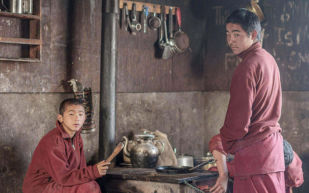 Two Nepali Boys in their kitchen at a house en route to Manaslu Circuit Trek Trail